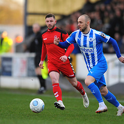 TELFORD COPYRIGHT MIKE SHERIDAN 22/12/2018 - Steph Morley of AFC Telford closes down Adam Dawson of Chester (Formerly of AFC Telford) during the Vanarama Conference North fixture between Chester FC and AFC Telford United at the Swansway Deva Stadium, Chester.
