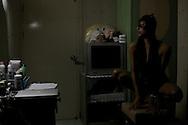 Fiona surveys her 'look' in the mirror. Bangkok, Thailand.