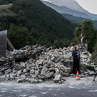 A tv troupe reports live next to a ruined house in the small village of Accumoli after a strong earthquake hit central Italy