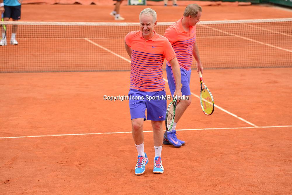 John McENROE prend la balle dans le dos - Patrick McENROE - 03.06.2015 - Jour 11 - Roland Garros 2015<br /> Photo : Dave Winter / Icon Sport