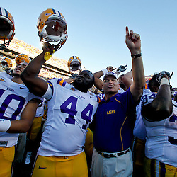 Oct 2, 2010; Baton Rouge, LA, USA; safety Rockey Duplessis (40), defensive tackle J.C. Copeland (44), head coach Les Miles and running back Stevan Ridley (34) celebrate following a victory over the Tennessee Volunteers at Tiger Stadium. LSU defeated Tennessee 16-14.  Mandatory Credit: Derick E. Hingle