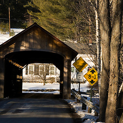 The .Coombs Covered Bridge spans the Ashuelot River in Winchester, New Hampshire.  Town Lattice Truss construction.  106 feet long, built in 1837.
