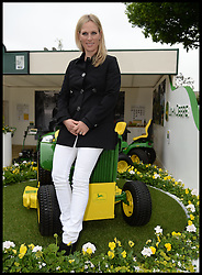 Zara Phillips sits on a John Deere Lawnmower, at the Chelsea Flower Show,to help celebrate 50 years of producing the John Deere lawnmower. Monday, 20th May 2013.Picture by Andrew Parsons / i-Images<br />