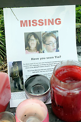 © Licensed to London News Pictures. 09/08/2012 . Candles and a missing poster at the bus stop near Castle Hill School and The Lindens.. Sixth day (09.08.2012) Tia Sharp has been missing..  12 years old Tia Sharp has been missing from the Lindens on The Fieldway Estate in New Addington,Croydon,Surrey since Friday last week. .Photo credit : Grant Falvey/LNP