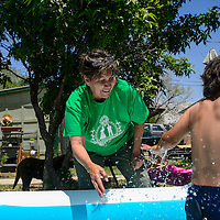 Leona Loisolle splashes her grandson Ian Samora, 5, Wednesday in Gallup. Loisolle recently moved in Gallup into her father's house after he passed away in August.