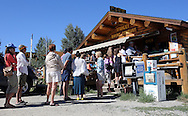 The line for Sunday morning breakfast at the Stanley Baking Company & Cafe winds out the door on July 14 2013, in Stanley, ID at the base of the Sawtooth Mountains.