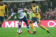 Ben Pearson and Arsenal midfielder Alex Oxlade-Chamberlain (15) battle during the The FA Cup 3rd round match between Preston North End and Arsenal at Deepdale, Preston, England on 7 January 2017. Photo by Pete Burns.