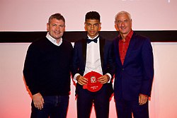 NEWPORT, WALES - Saturday, May 19, 2018: Chem Campbell is presented with his cap by Osian Roberts (left) and Ian Rush (right) during the Football Association of Wales Under-16's Caps Presentation at the Celtic Manor Resort. (Pic by David Rawcliffe/Propaganda)