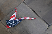 After a rain shower, an American Stars and Stripes flag bandana lies on the wet pavement in the City of London, the UK capital's financial district, on 17th August 2020, in the City of London, England.