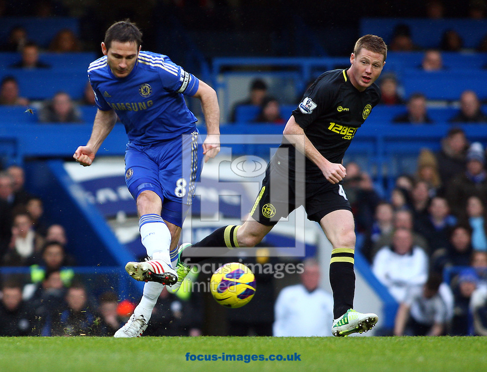 Picture by Rob Fisher/Focus Images Ltd +44 7545 398891.09/02/2013.Frank Lampard of Chelsea and James McCarthy of Wigan Athletic during the Barclays Premier League match at Stamford Bridge, London.