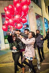 © Licensed to London News Pictures . 14/02/2016 . Manchester , UK . Revellers in Manchester out overnight on Valentine's Day evening . Photo credit : Joel Goodman/LNP