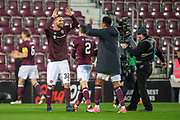Goalscorer Sean Clare (#9) of Heart of Midlothian is congratulated by new signing David Vanecek (#32) of Heart of Midlothian FC after the final whistle of the 4th round of the William Hill Scottish Cup match between Heart of Midlothian and Livingston at Tynecastle Stadium, Edinburgh, Scotland on 20 January 2019.