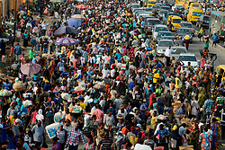 March 30, 2020, Lagos, Nigeria: Lagos residents, despite social distancing order, cluster at Oke-Odo Market, Lagos Nigeria on Monday March 30, 2020 for last minute shopping. Federal Government has announced on Sunday, March 29, and declared total lockdown with effective from Monday 11pm in Lagos, Ogun State and Abuja, the nation capital, to tame the spread of coronavirus (COVID-19) pandemic. (Credit Image: © Adekunle Ajayi/NurPhoto via ZUMA Press)