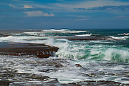 Looking across waves breaking across the coral coast. Fiji