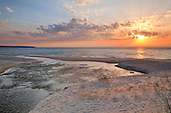 Otter Creek meets Lake Michigan at sunset.  <br />
