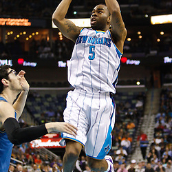 February 1, 2011; New Orleans, LA, USA; New Orleans Hornets guard Marcus Thornton (5) shoots over Washington Wizards guard Kirk Hinrich (12) during the second quarter at the New Orleans Arena.   Mandatory Credit: Derick E. Hingle