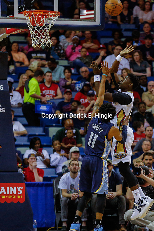 Mar 21, 2017; New Orleans, LA, USA; New Orleans Pelicans guard Jrue Holiday (11) shoots over Memphis Grizzlies guard Mike Conley (11) during the first quarter of a game at the Smoothie King Center. Mandatory Credit: Derick E. Hingle-USA TODAY Sports