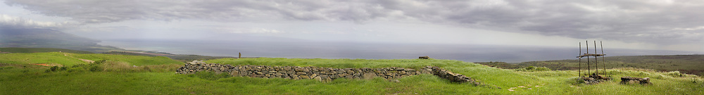 MOLOKAI, HI - A panoramic view of a sacred hula heiau mound on the Pacific island of Molokai, Hawaii.  A heiau is a Hawaiian temple comprised of a stone platform with various structures built upon it.  The structures on the platform were used to house priests, sacred ceremonial drums, sacred items and other things associated with that particular temple.