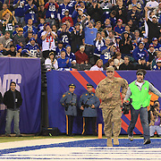 Air Force Tech. Sgt. David H. Brenhuber, of Cherry Hill, N.J. who is serving in Afghanistan, runs onto the field to hug his wife Tammy and daughter Alexis after a surprise reunion during the first half of the New York Giants Vs Green Bay Packers, NFL American Football match at MetLife Stadium, East Rutherford, New Jersey, USA. 17th November 2013. Photo Tim Clayton