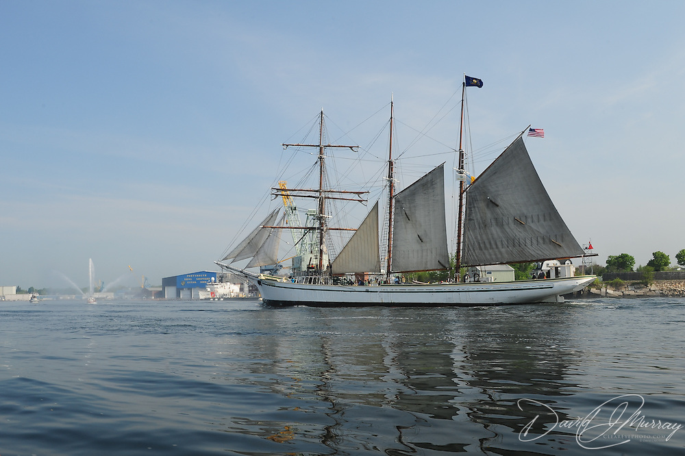 Tall ship Gazela sails up the Piscataqua River in Portsmouth, NH , passing in front of the Portsmouth Naval Shipyard