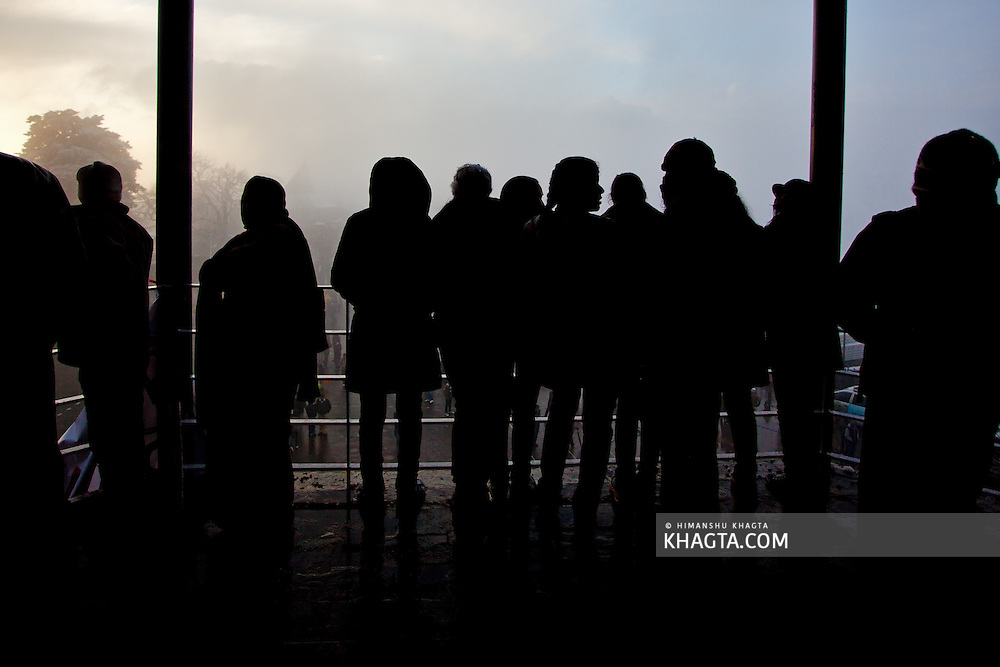 Silhouette of a group of people watching the Ridge of Shimla on new years eve after the town received its first snowfall of the season.