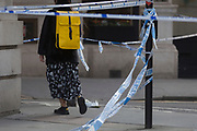 The morning after the terrorist attack at Fishmongers Hall on London Bridge, in which Usman Khan (a convicted, freed terrorist) killed 2 during a knife a attack, then subsequently tackled by passers-by and shot by armed police - members of the public walk around the cordoned off area, on 30th November 2019, in London, England.