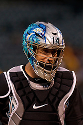 June 28, 2011; Oakland, CA, USA; Florida Marlins catcher John Buck (14) stands behind home plate against the Oakland Athletics during the first inning at the O.co Coliseum.  Oakland defeated Florida 1-0.
