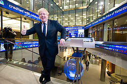 © London News Pictures. 12/02/2013 . London, UK. Mayor Of London, BORIS JOHNSON poses for photographers at the entrance to The London Stock Exchange after opening the days trading at the London Stock Exchange with Xavier Rolet, CEO of London Stock Exchange Group.  Photo credit : Ben Cawthra/LNP
