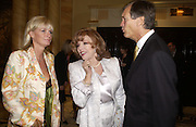 Joan Collins and Mr. and Mrs. Charles Delavigne, pay tribute to Joan Collins at a  lunch  at The Dorchester. 14th May 2004. ONE TIME USE ONLY - DO NOT ARCHIVE  © Copyright Photograph by Dafydd Jones 66 Stockwell Park Rd. London SW9 0DA Tel 020 7733 0108 www.dafjones.com