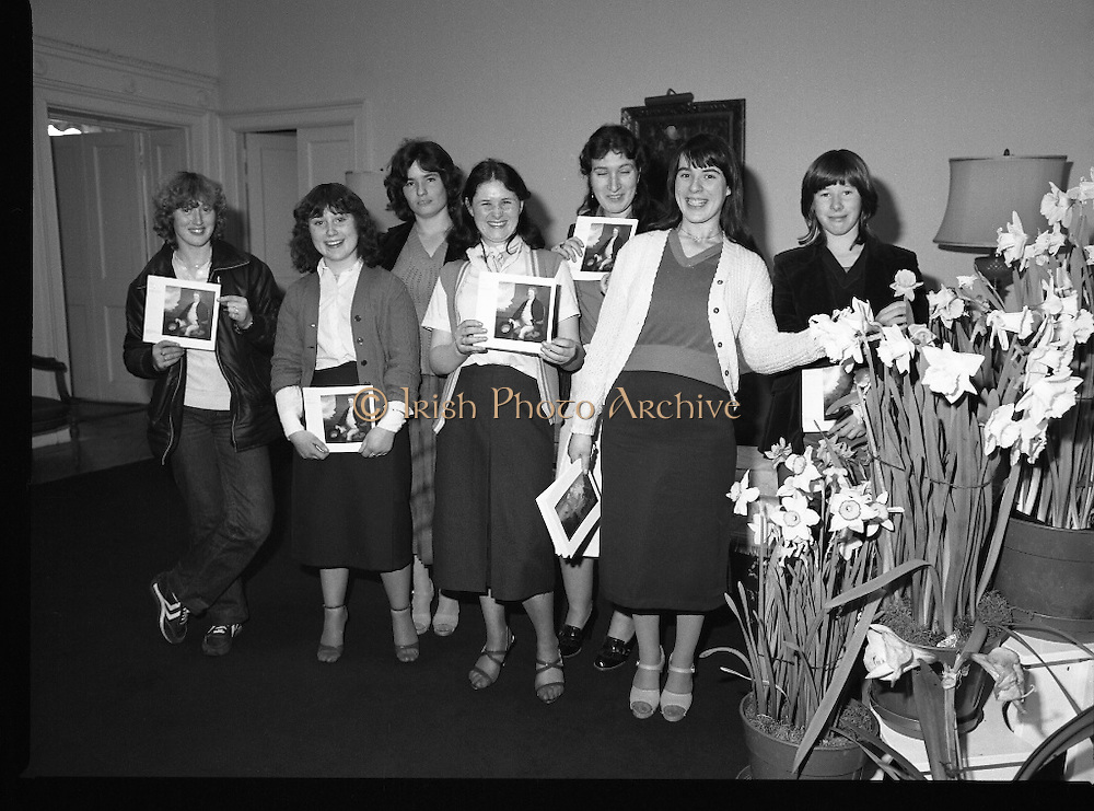 Galway Travellers Visit U.S.Embassy.    (N67)..1981..01.04.1981..04.01.1981..1st April 1981..Elizabeth,the wife of American Ambassador Mr William Shannon,invited a group of Galway travellers to afternoon tea at the residence in Phoenix Park, Dublin...The Galway ladies are pictured with their commemorative books as they pose beside seasonal daffodils.