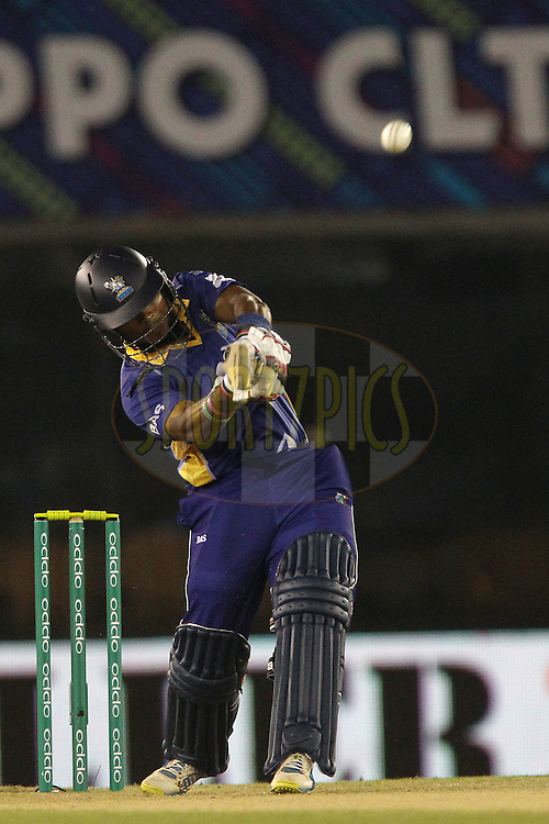 Dilshan MUNAWEERA launches a six during match 5 of the Oppo Champions League Twenty20 between the Kings XI Punjab and the Barbados Tridents held at the Punjab Cricket Association Stadium, Mohali, India on the 20th September 2014<br /> <br /> Photo by:  Ron Gaunt / Sportzpics/ CLT20<br /> <br /> <br /> Image use is subject to the terms and conditions as laid out by the BCCI/ CLT20.  The terms and conditions can be downloaded here:<br /> <br /> http://sportzpics.photoshelter.com/gallery/CLT20-Image-Terms-and-Conditions-2014/G0000IfNJn535VPU/C0000QhhKadWcjYs