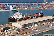 The cargo ship Kwanza alongside the dock at eh Port of Valencia in Spain.