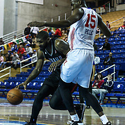 Idaho Stampede Forward Richard Howell (24) drives towards the basket as Delaware 87ers Forward Norvel Pelle (15) defends in the second half of a NBA D-league regular season basketball game between Delaware 87ers and Idaho Stampede Thursday, Dec. 12, 2013 at The Bob Carpenter Sports Convocation Center, Newark, DE