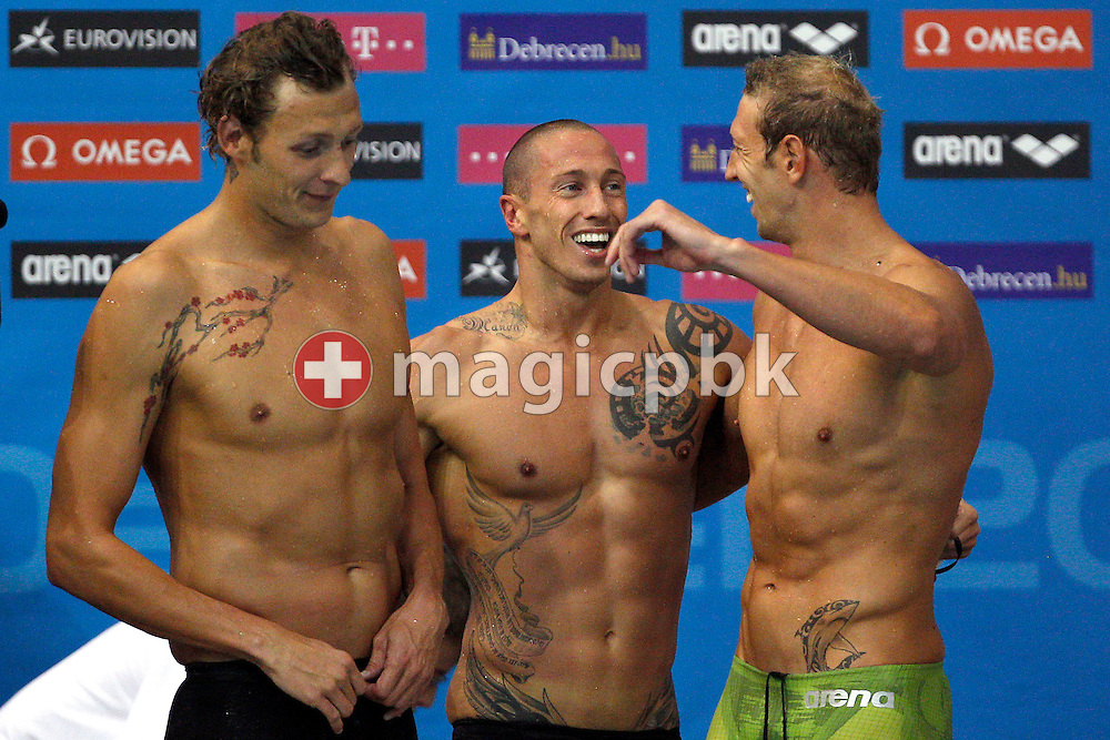 Amaury Leveaux (L-R), Frederick Bousquet and Alain Bernard react after winning the men's 4x100m Freestyle Relay Final during the 31st LEN European Swimming Championships in Debrecen, Hungary, Monday, May 21, 2012. (Photo by Patrick B. Kraemer / MAGICPBK)