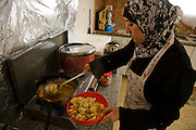 Abdul-Baset Razem's wife prepares a meal at their home in a Palestinean village in East Jerusalem.  (Abdul-Baset Razem is featured in the book What I Eat: Around the World in 80 Diets.)