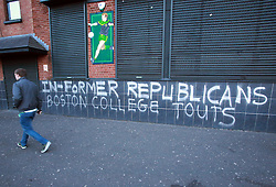 A man walks past graffiti relating to the Boston College tapes on the Falls Road, west Belfast, Northern Ireland, on May 2, 2014.Former loyalist and republican paramilitaries gave a series of candid interviews that chronicled their involvement in the Northern Ireland Troubles. Recordings of these interviews, in which a number of allegations were made about Sinn Fein leader Gerry Adams' involvement with the IRA, were held in a library at Boston College in the US, and became known as the Boston tapes. Police in Northern Ireland have been granted more time to question Irish republican leader Gerry Adams, head of the Sinn Fein political party who is being held over the murder of a woman in 1972. Northern Ireland police applied for more time to question republican leader Gerry Adams over a notorious IRA murder in 1972... Picture by Paul McErlane / i-Images