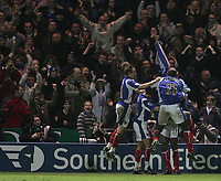 Photo: Lee Earle.<br /> Portsmouth v Manchester City. The Barclays Premiership. 10/02/2007.Kanu is congratulated after scoring Portsmouth's winning goal.