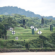 Navigation markers on the banks of the Panama Canal. Opened in 1914, the Panama Canal is a crucial shipping lane between the Atlantic and Pacific Oceans that mean that ships don't have to go around the bottom of South America or over the top of Canada. The Canal was originally built and owned by the United States but was handed back to Panama in 1999.
