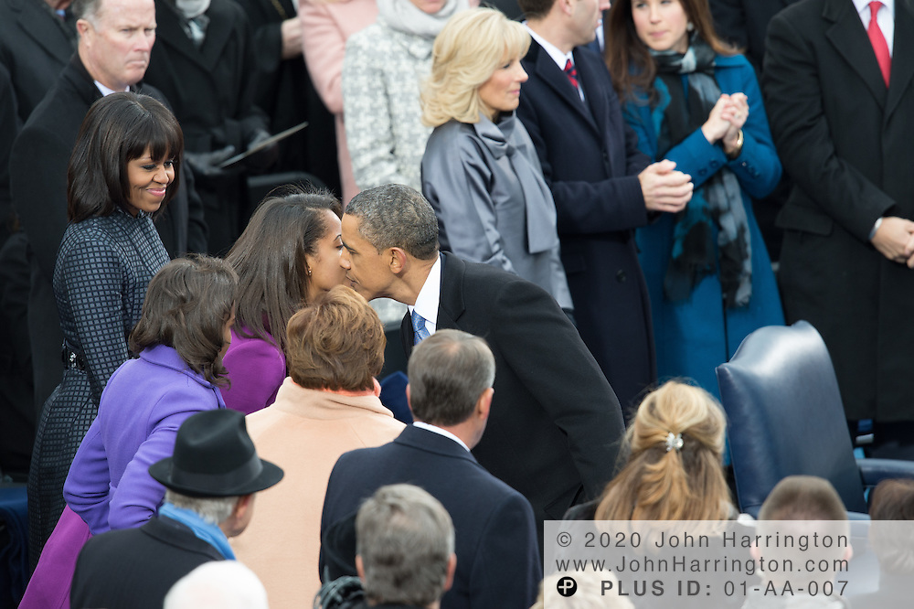 President Obama is congratulated by daughter Sasha at the conclusion of President Obama's second inaugural address during the 57th Presidential Inauguration of President Barack Obama at the U.S. Capitol Building in Washington, DC January 21, 2013.
