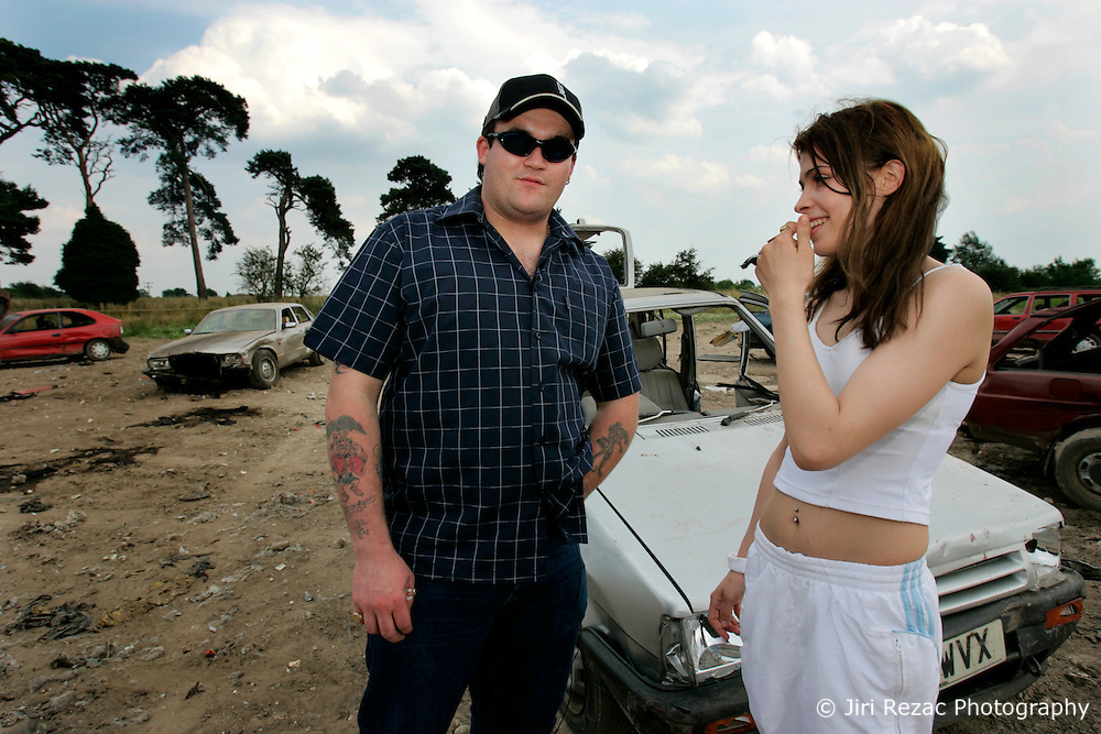 UK ENGLAND NORFOLK SWAFFHAM 14JUL05 - Micheal Carroll, a 22-year old binman who turned a millionnaire by winning £ 9.7 million in the National Lottery poses for photos with his girlfriend Sammy Howard (17) amongst old banger car he raced and crashed on a 3-acre field behind his estate in Swaffham, Norfolk. The self-styled 'King of Chavs' was recently served with an anti-social behaviour order after driving through Downham Market in Norfolk firing ball bearings from his window.  ..jre/Photo by Jiri Rezac..© Jiri Rezac 2005..Contact: +44 (0) 7050 110 417.Mobile:  +44 (0) 7801 337 683.Office:  +44 (0) 20 8968 9635..Email:   jiri@jirirezac.com.Web:    www.jirirezac.com