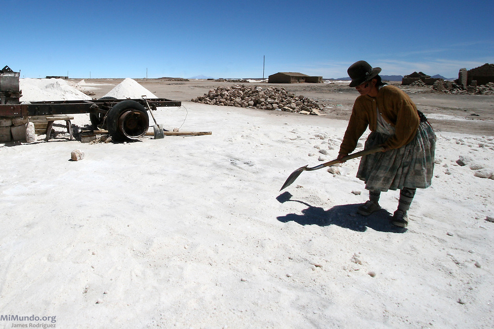A woman salt mines in Uyuni. Since 2010, Bolivian state-run mining company Comibol has been exploring lithium reserves in the Salar de Uyuni, the world's largest salt flat. The Salar de Uyuni sits at 3,600 meters above sea level and has a total surface area of 10,582 square kilometers.