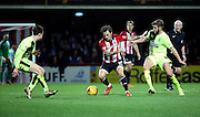Brentford midfielder Sam Saunders trying to find some space during the Sky Bet Championship match between Brentford and Huddersfield Town at Griffin Park, London, England on 19 December 2015. Photo by Matthew Redman.