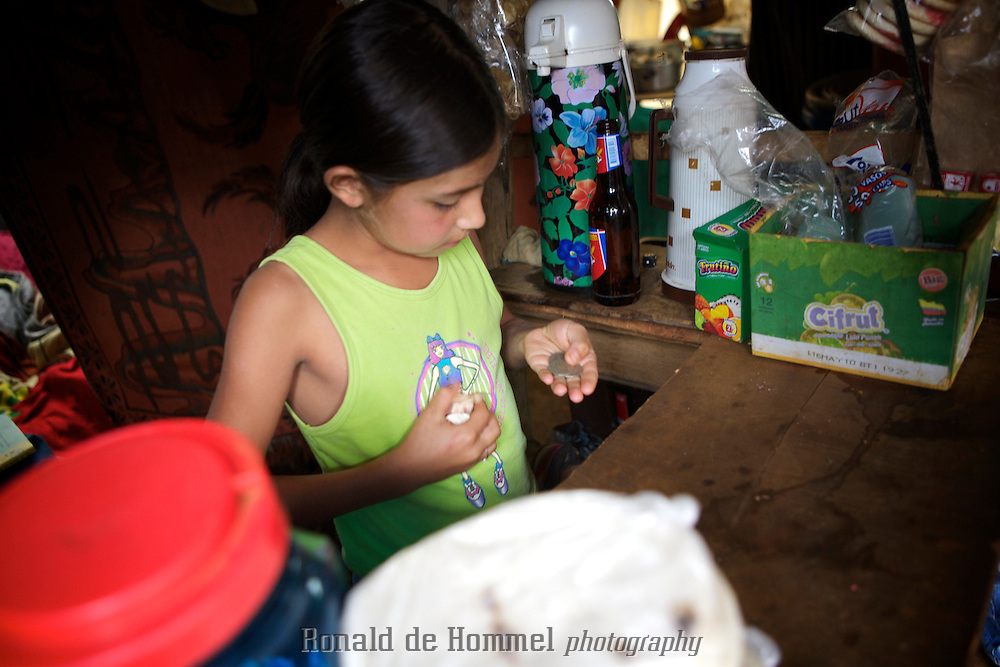 Paula, an eleven year old girl lives in the new 'barrio de invasion' los Manantiales high above Medellin, the second city of Colombia. She and her family had to flee violence in another part of the country.