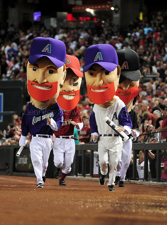 Sep. 24 2011; Phoenix, AZ, USA; Arizona Diamondbacks legend character Mark Grace (left), Matt Williams, Luis Gonzalez  and Randy Johnson race during the sixth inning against the San Francisco Giants at Chase Field. Mandatory Credit: Jennifer Stewart-US PRESSWIRE