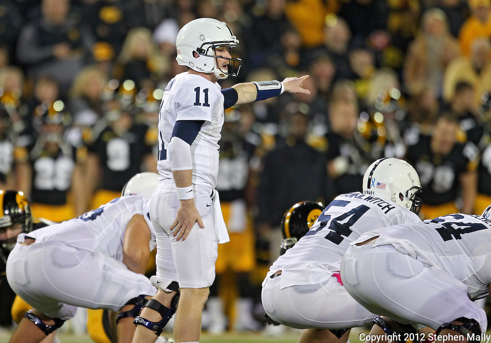 October 20 2012: Penn State Nittany Lions quarterback Matthew McGloin (11) points to the defense during the first half of the NCAA football game between the Penn State Nittany Lions and the Iowa Hawkeyes at Kinnick Stadium in Iowa City, Iowa on Saturday October 20, 2012. Penn State defeated Iowa 38-14.