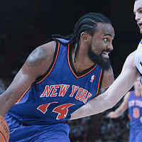 06 October 2010: New York Knicks center Ronny Turiaf #14 drives past Minnesota Timberwolves forward Kevin Love during the Minnesota Timberwolves 106-100 victory over the New York Knicks, during 2010 NBA Europe Live, at the POPB Arena in Paris, France.