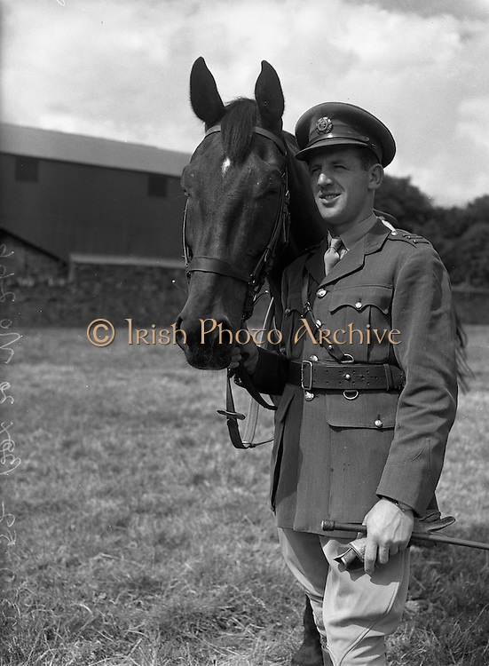 25/07/1952 <br /> 07/25/1952<br /> 25 July 1952<br /> Army Equitation School McKee Barracks, Cabra, Dublin.  Captain M. Tubridy with &quot;Atherloe&quot;.