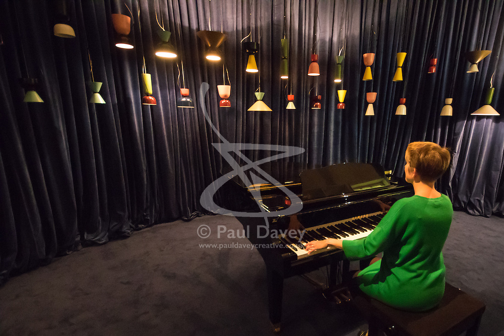 "Somerset House, London, September 21st 2015. A pianist's keys are connected to 44 Alphabeta lamps in ""Hem"", the creation of Italian designer Luca Nichetto, at Somerset House as part of the London Design Festival which runs between September 19th and 27th with a series of artworks and installations created through the collaborations of internationally renowned designers and brands.  // Contact: paul@pauldaveycreative.co.uk Mobile 07966 016 296"
