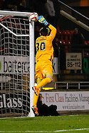 Gary Harkins of Oldham Athletic can't stop the equalising goal from Korey Smith of Oldham Athletic (not shown) during the Sky Bet League 1 match at the Matchroom Stadium, London<br /> Picture by David Horn/Focus Images Ltd +44 7545 970036<br /> 25/03/2014