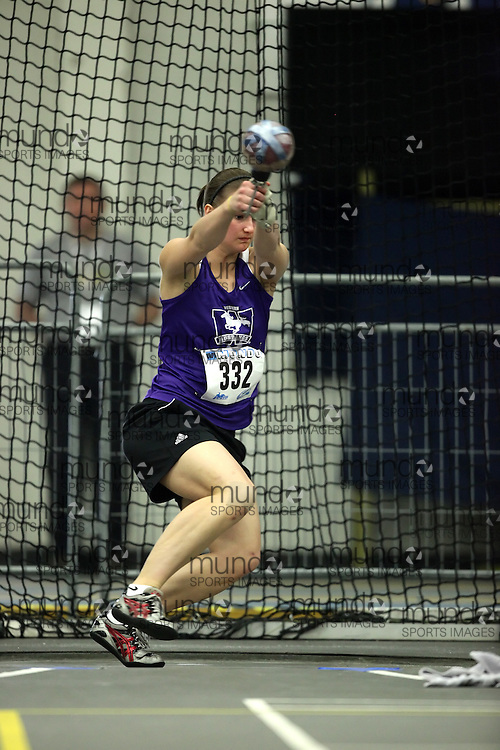(Windsor, Ontario---11 March 2010) Jenine McCutcheon of University of Western Ontario Mustangs competes in the  competes in the weight throw at the 2010 Canadian Interuniversity Sport Track and Field Championships at the St. Denis Center. Photograph copyright Geoff Robins/Mundo Sport Images. www.mundosportimages.com